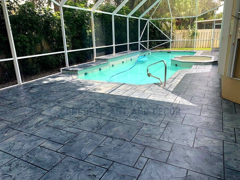 gray geometric tile concrete overlay on pool deck