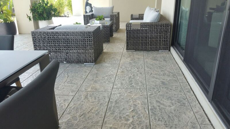 modern large tile pattern stamped concrete patio