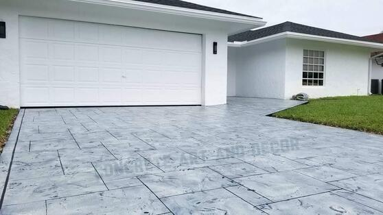 Picture of a finished driveway in a modern concrete overlay design.