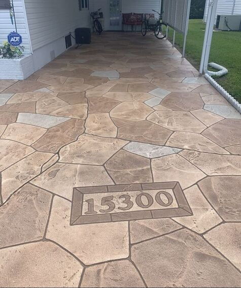 custom driveway resurfacing in natural color stone pattern