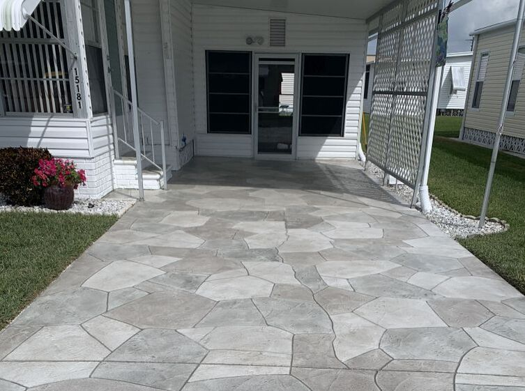 Stamped concrete driveway design in three different stone colors