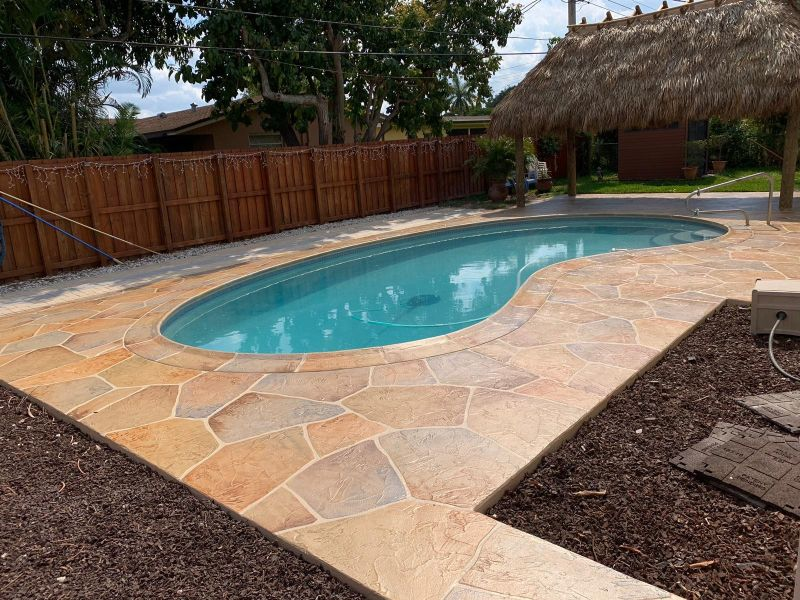 outdoor pool deck completed in stamped concrete