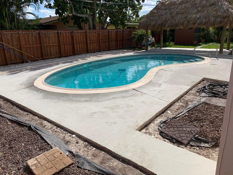 before complete concrete pool deck resurfacing using decorative concrete overlays