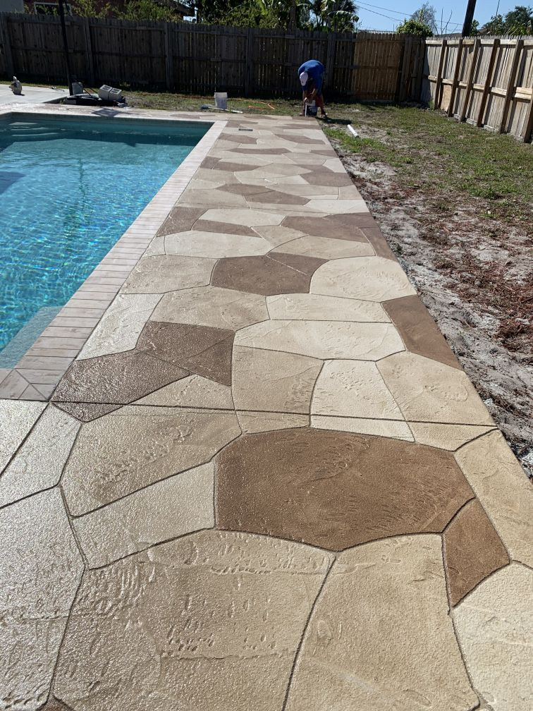 multi-color concrete patio in stone pattern overlay