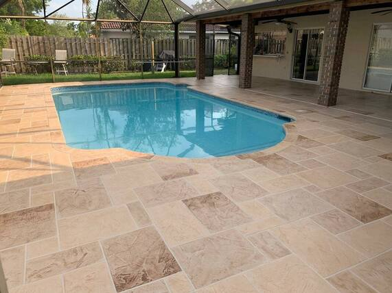 concrete pool deck completed in modern geometric tile stamped concrete pattern