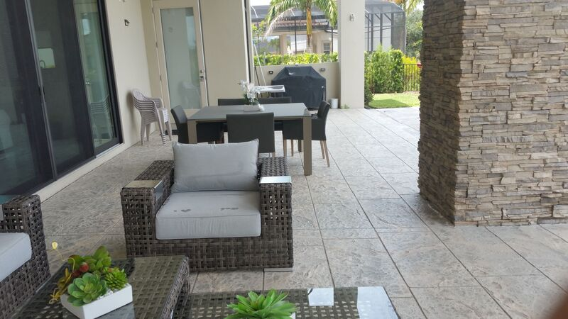 modern patio furniture on concrete patio
